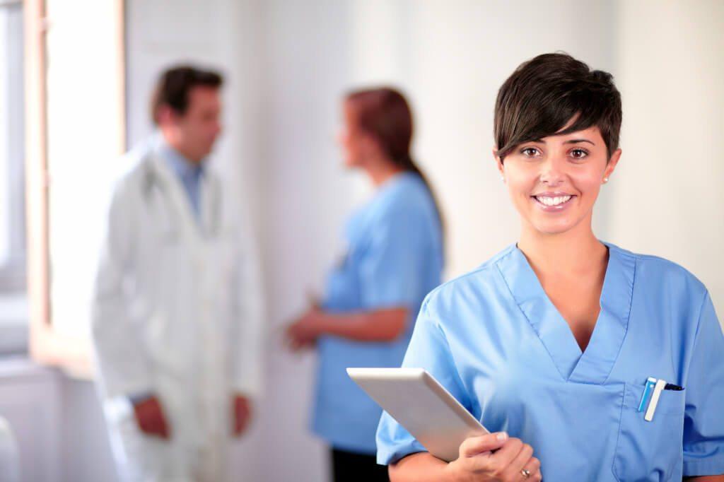 Lovely latin nurse on blue uniform standing