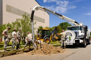 116th Civil Engineering Squadron repair drainage problem 130413 Z XI378 009