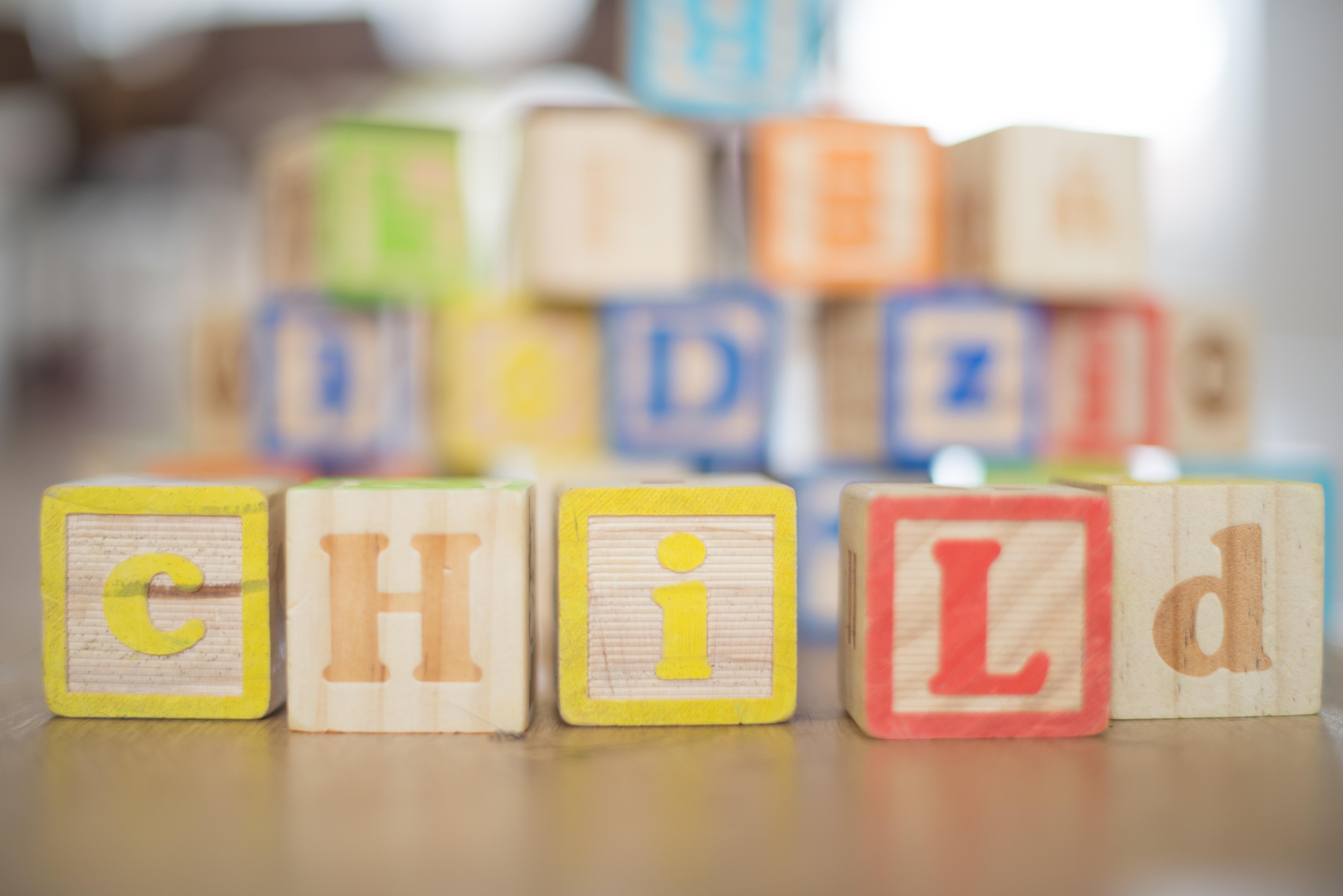 child in blocks canva